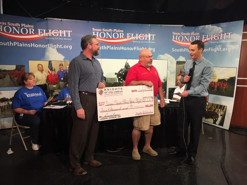 The now famous HONOR FLIGHT receives $5000.00 from Knights of Columbus 2571, Slaton, TX.